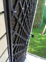 Кованые дверцы для дровницы