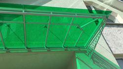 Кованый козырек с зеленым монолитным поликарбонатом
